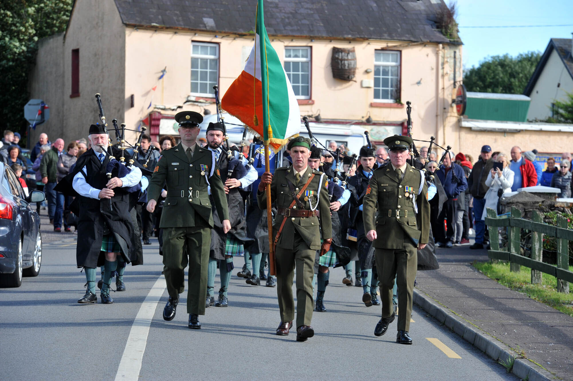 The Tricolour flag is borne by members of the army at the Dripsey Ambush Centenary Anniversary Parade from Dripsey Cross to the ambush site on Sunday 3rd October 2021.